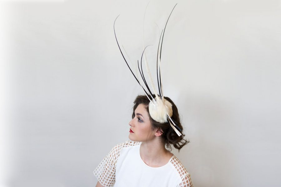 This headpiece could be worn to a less conventional wedding or is perfect for Ascot. It is a small feather fascinator base with black and white feather quills sprayed out.
