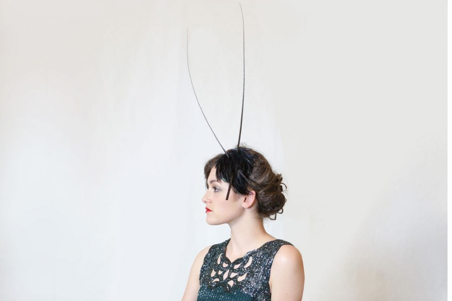 Feather base with tall quills, this is a minimal and elegant headpiece with lots of impact.