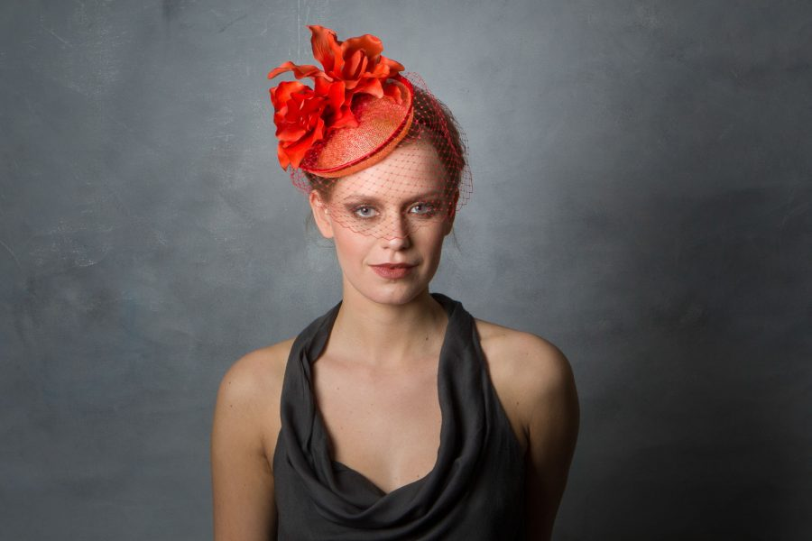 Orange flower, Cherry Red birdcage veil, and Coral sinamay base