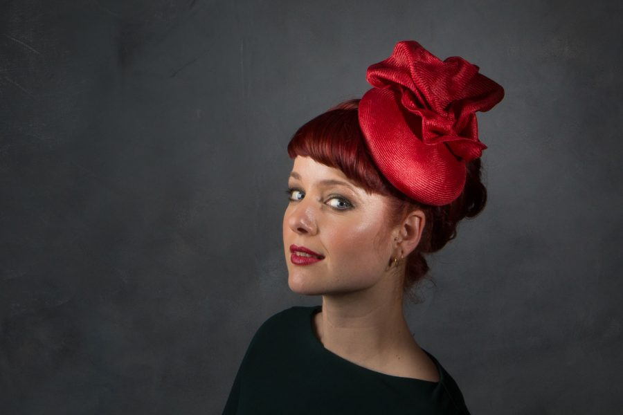 This hat fascinator is moulded around a cute 'button' hat block out of Parasisal (a very good quality straw) and so makes for a lovely summer occasion hat.
