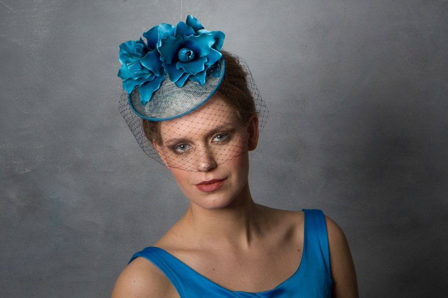 This bright blue wedding fascinator hat has lots of different shades of blue combined; Navy, Teal, Azure, Baby Blue