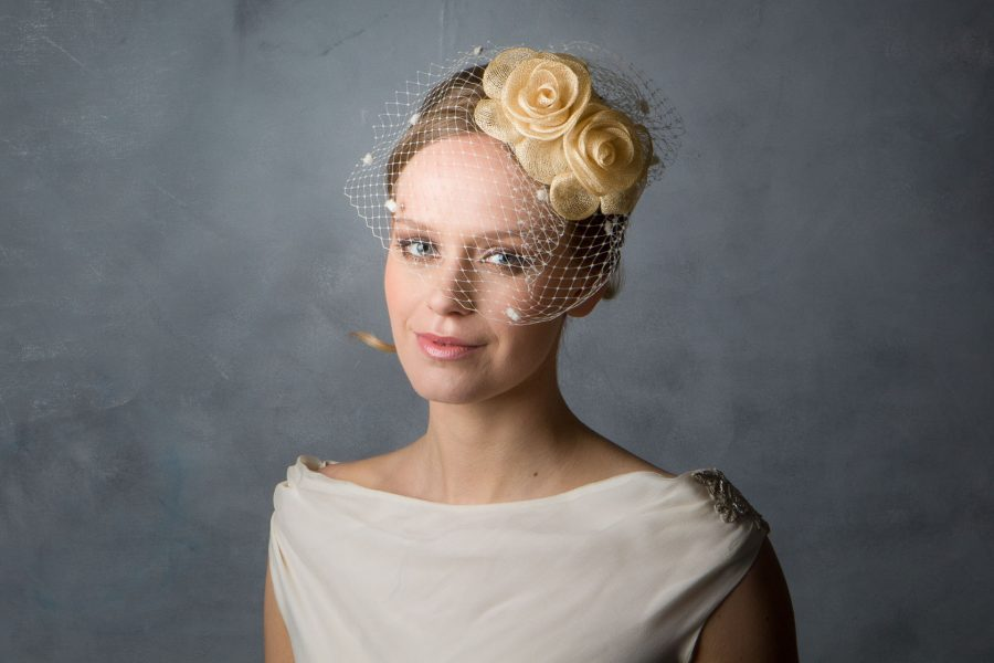 Sinamay Bridal fascinator held with millinery elastic. With dotted birdcage veil.