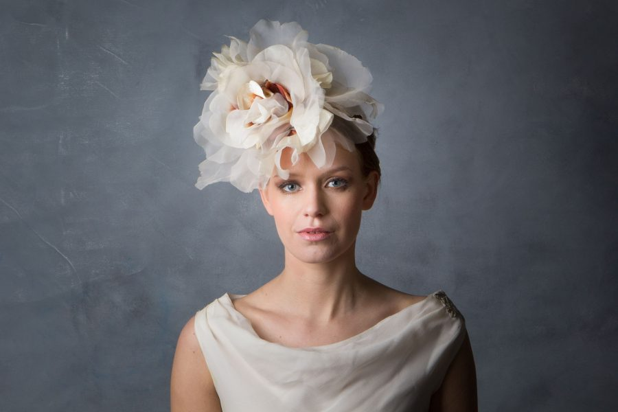 This oversized Flower headpiece is made from various organza's, velveteens, and other materials in creams and off-whites, to give a vintage look. Perfect for a Bohemian style wedding. Photograph by Gisela Torres.